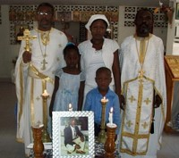 Reader Vladimir's widow<br/>and children pose with mission clergy after<br/> funeral service in Port-au-Prince.