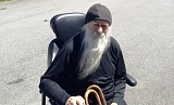 Fr Job in his new mobile chair.